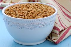 Delicious and healthy granola cereal. Delicious and nutritious lightly toasted breakfast muesli or granola cereal on vintage styling Stock Photo