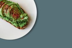 Delicious and nutritious veggie toast or sandwich with avocado and guacamole in a minimal style. Healthy food. A useful. Snack. Nearby place for text Royalty Free Stock Images