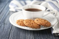 Delicious oatmeal cookies with chocolate chips. And cup of coffee on plate Royalty Free Stock Image