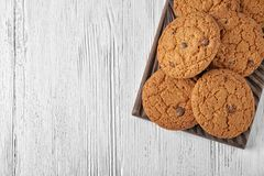 Delicious oatmeal cookies with chocolate chips. On wooden board Royalty Free Stock Photos