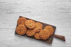 Delicious oatmeal cookies with chocolate chips. On wooden board Royalty Free Stock Photography