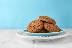 Delicious oatmeal cookies with chocolate chips. On plate Stock Photo