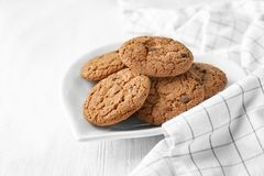 Delicious oatmeal cookies with chocolate chips. On plate Royalty Free Stock Photography