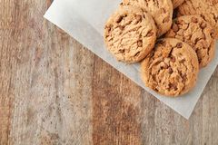 Delicious oatmeal cookies with chocolate chips. On wooden table Stock Photos