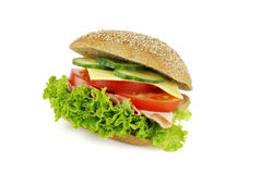 Delicious occupied wholemeal bun. S on white background Stock Photos