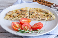 Delicious omelet with mushrooms and tomatoes Royalty Free Stock Image