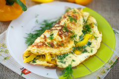 Delicious omelet with peppers and herbs Stock Image
