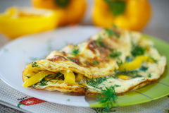 Delicious omelet with peppers and herbs Stock Images