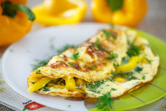 Delicious omelet with peppers and herbs Stock Photo