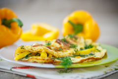 Delicious omelet with peppers and herbs Royalty Free Stock Images