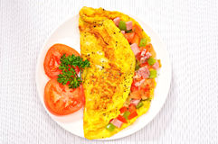 Delicious omelet with tomato, pepper, ham, basil Royalty Free Stock Photos