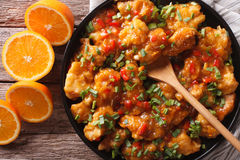 Delicious orange chicken fillets close-up on a plate. horizontal Royalty Free Stock Image
