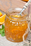 Delicious orange marmalade in a glass jar, vertical Royalty Free Stock Photo