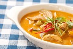 Delicious orange Thai panang curry in white bowl Stock Photos
