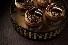 Delicious Oreo cupcakes on dark background. selective focus Royalty Free Stock Photography