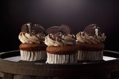 Delicious Oreo cupcakes on dark background. selective focus Royalty Free Stock Images