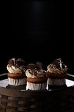 Delicious Oreo cupcakes on dark background. selective focus Royalty Free Stock Photo