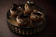Delicious Oreo cupcakes on dark background. selective focus Royalty Free Stock Image