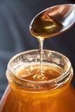 Delicious organic natural bio honey in a glass jar stock photos