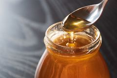 Delicious organic natural bio honey in a glass jar stock photography