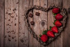 Delicious organic strawberries with dark chocolate stock images