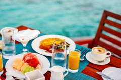 Breakfast at ocean edge. Delicious organic ts, eggs, juice and coffee served for breakfast at tropical ocean edge in a luxury resort Royalty Free Stock Images