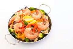 Delicious paella in pan. Delicious paella with seafood in a frying pan stock photo