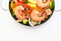 Delicious paella in pan. Delicious paella with seafood in a frying pan royalty free stock images