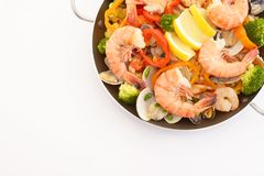 Delicious paella in pan. Delicious paella with seafood in a frying pan royalty free stock photos