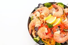 Delicious paella in pan. Delicious paella with seafood in a frying pan stock photos