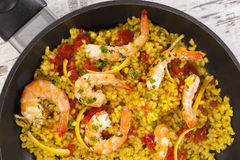 Delicious paella in pan with shrimps. Royalty Free Stock Photos