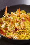 Delicious paella in pan with shrimps Stock Image