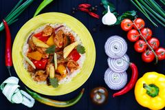 Delicious Pan-Asian food, appetizing spicy rice with chicken, pi stock images