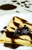 Delicious pancake covered with chocolate Royalty Free Stock Photos