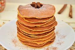Delicious Pancake. Laid out in a pile, decorated with icing sugar, ground cinnamon and Dittany Stock Photography