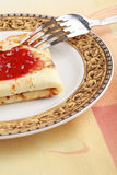 Delicious pancake with red jam in a plate Royalty Free Stock Photo
