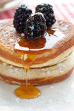 Delicious pancakes. Stacked together with blackberries and honey Royalty Free Stock Photography