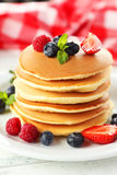 Delicious pancakes with berries on a white wooden background Royalty Free Stock Photography