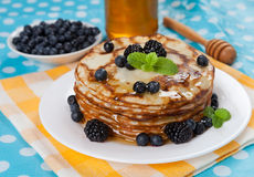 Delicious pancakes with blackberries and mint leaves Stock Image