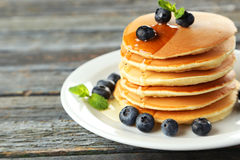Delicious pancakes with blueberries on blue wooden background Stock Photo