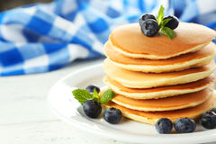 Delicious pancakes with blueberries on a white wooden background Stock Photo
