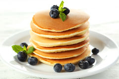 Delicious pancakes with blueberries on a white wooden background Stock Photography