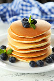 Delicious pancakes with blueberries on white wooden background Stock Images