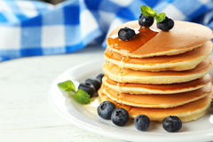 Delicious pancakes with blueberries on white wooden background Stock Photography