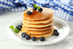 Delicious pancakes with blueberries on a white wooden background Royalty Free Stock Image
