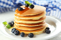 Delicious pancakes with blueberries on white wooden background Royalty Free Stock Image