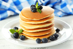 Delicious pancakes with blueberries on white wooden background. Stock Photo