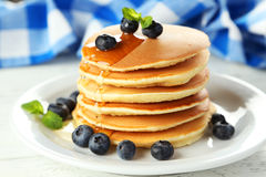 Delicious pancakes with blueberries on white wooden background. Stock Photography