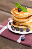 Delicious pancakes with blueberry and mint royalty free stock photo
