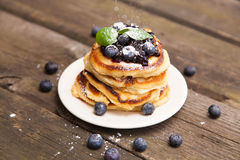 Delicious pancakes with blueberry and mint royalty free stock photography
